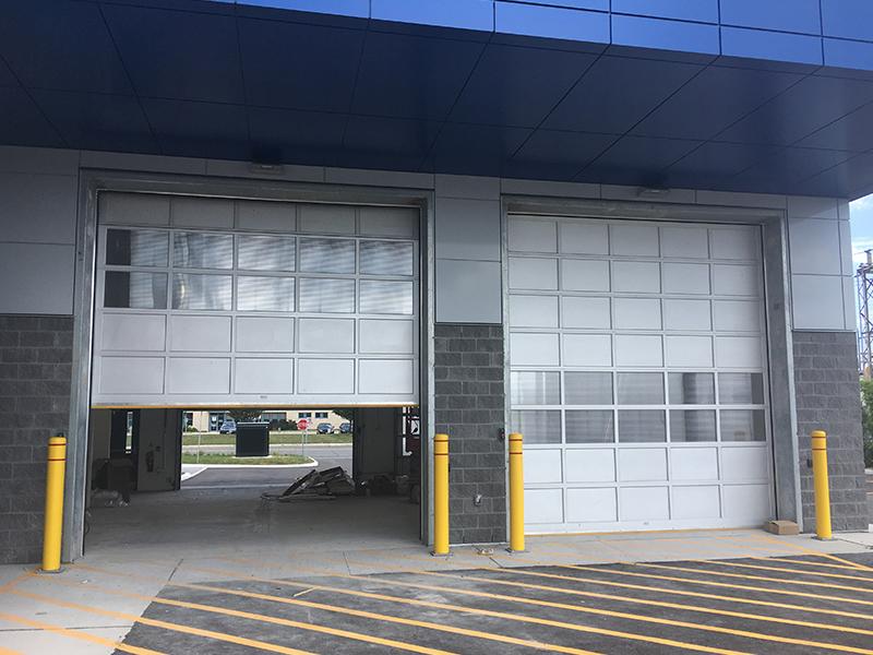 Commercial garage door for mechanic shop - Mckee Horrigan Inc.