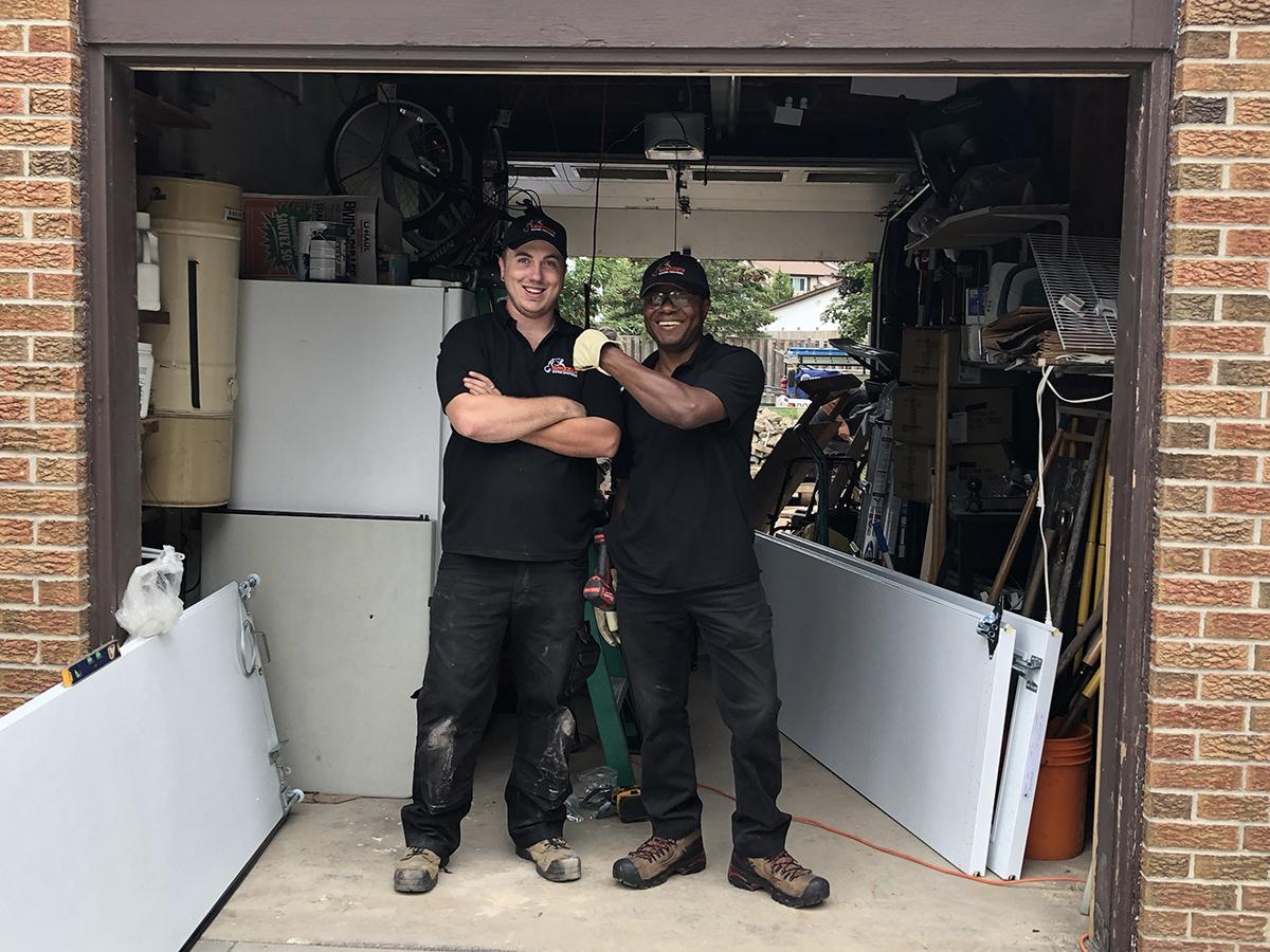 Team members building Residential garage doors - Mckee Horrigan Inc.